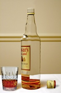 Almost empty whisky bottle