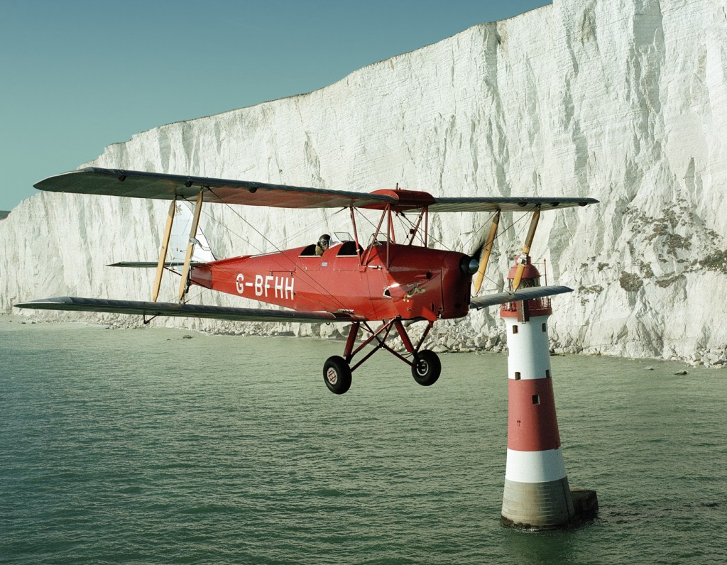 De Havilland Tiger Moth over Beachy Head Lighthouse, Southern England