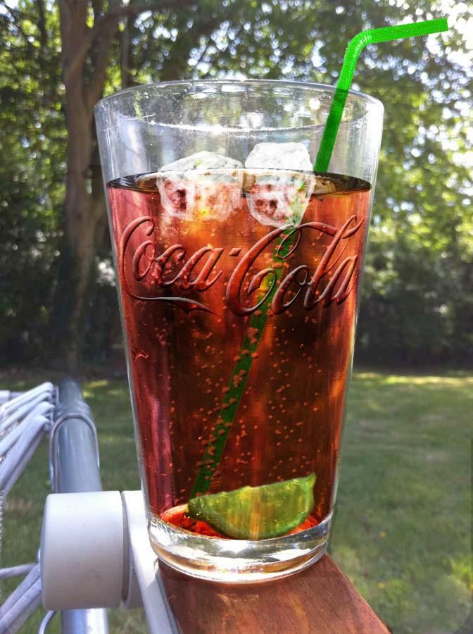 Half full Coke Glass
